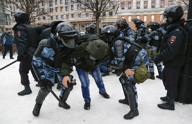 Police detain a man during a protest against the jailing of opposition leader Alexei Navalny in Moscow, Russia, Saturday, January 23, 2021. (Photo by Alexander Zemlianichenko/AP Photo)