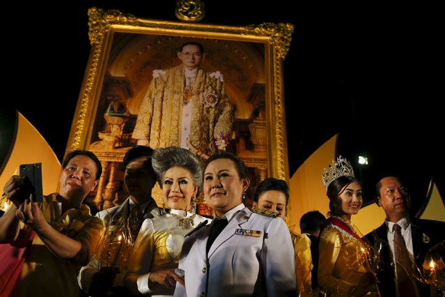 Army officials and guests pose after attending the official ceremony to celebrate Thailand's King Bhumibol Adulyadej 88th birthday in Bangkok, Thailand, December 5, 2015. (Photo by Jorge Silva/Reuters)