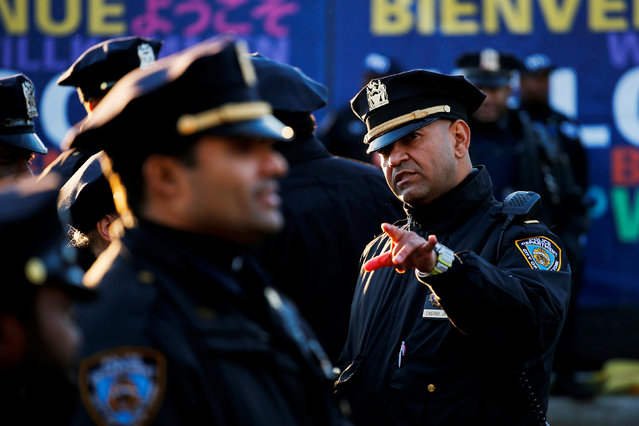 NYPD officers stand guard as runners arrive to compete in the 2016 New York City Marathon in the Manhattan borough of New York City, U.S., November 6, 2016. (Photo by Eduardo Munoz/Reuters)