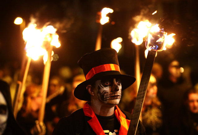 People parade with torches as part of bonfire night celebrations in Edenbridge, Britain November 5, 2016. (Photo by Neil Hall/Reuters)