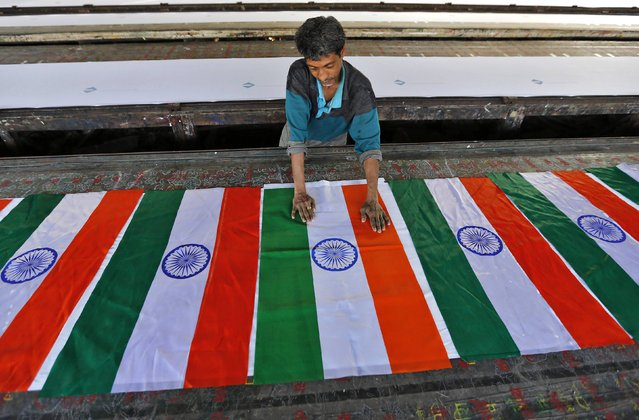 A worker makes Indian national flags at a workshop ahead of Republic Day celebrations in the western Indian city of Ahmedabad January 23, 2015. (Photo by Amit Dave/Reuters)