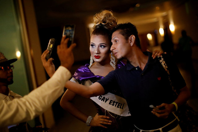 A contestant of Miss Gay Nicaragua 2018 takes selfies with a friend at a hotel in Managua, Nicaragua, June 27, 2018. (Photo by Andres Martinez Casares/Reuters)