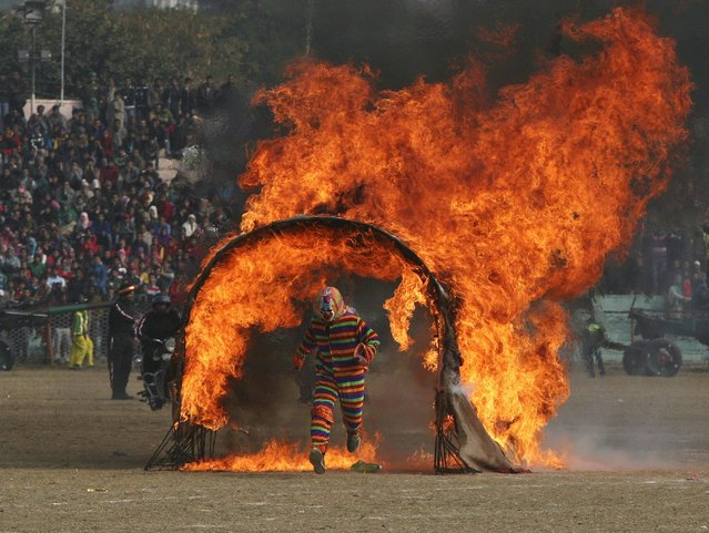 An Indian policeman performs a stunt during the Republic Day parade in Jammu January 26, 2015. (Photo by Mukesh Gupta/Reuters)