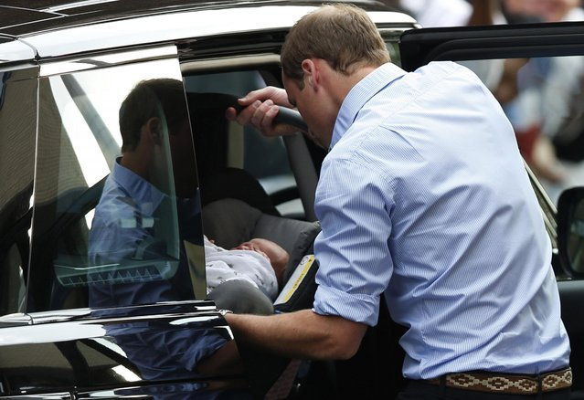 Britain's Prince William places carefully the Prince of Cambridge into a car, Tuesday July 23, 2013, as they leave St. Mary's Hospital exclusive Lindo Wing in London where the Duchess gave birth on Monday July 22. (Photo by Sang Tan/AP Photo)