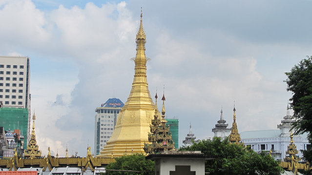 In this October 3, 2016 photo, a golden stupa stands in a temple compound surrounded by modern buildings in Yangon, Myanmar. (Photo by Elaine Kurtenbach/AP Photo)