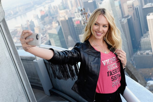 Victoria's Secret Angel Candice Swanepoel Lights The Empire State Building In Pink Stripes on December 7, 2015 in New York City. (Photo by Dimitrios Kambouris/Getty Images for Victoria's Secret)