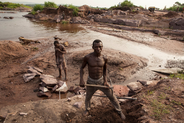 Stone miner on the banks of the Fleuve Congo in the Republic of Congo, 2010. (Photo by Hugh Brown/South West News Service)