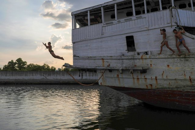 A boy jumps into the water at Sunda Kelapa port, on World Water Day in Jakarta, Indonesia, March 22, 2021. (Photo by Willy Kurniawan/Reuters)