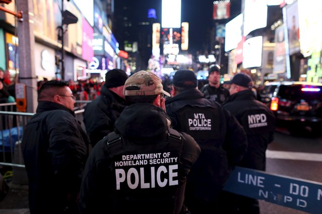 Members of the Department of Homeland Security monitor crowds during New Year celebrations in Times Square in the Manhattan borough of New York December 31, 2015. (Photo by Andrew Kelly/Reuters)