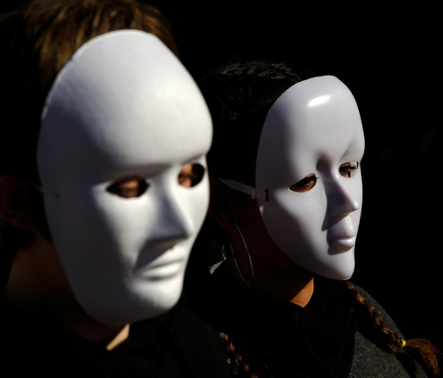 Gender studies students wear masks during a performance to commemorate victims of gender violence, during the U.N. International Day for the Elimination of Violence against Women in Oviedo, Spain November 25, 2016. (Photo by Eloy Alonso/Reuters)