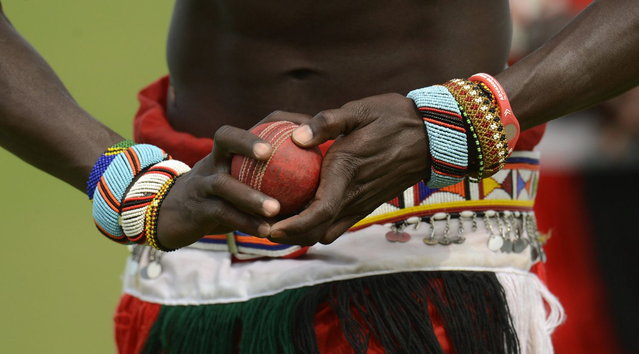 "A member of the Maasai cricket warrior team from Kenya holds a ball before a cricket match against English team ""The Shed"" during the Last Man Stands cricket tournament at Dulwich sports ground in south London September 1, 2013. (Photo by Philip Brown/Reuters)"