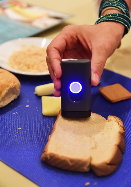The DietSensor analyses food with a click of a button using a micro scale and SCIO, the first molecular sensor that fits in a hand at Pepcon, January 5, 2016 in Las Vegas, Nevada ahead of the CES 2016 Consumer Electronics Show. The DietSensor's app automatically logs the food and gives advise to help the user make better food choices. (Photo by Robyn Beck/AFP Photo)