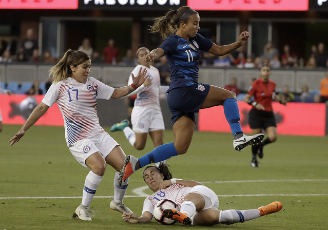 United States' Mallory Pugh (11) jumps over Chile's Camila Saez (18) and past Geraldine Leyton (17) during the first half of an international friendly soccer match in San Jose, Calif., Tuesday, September 4, 2018. (Photo by Jeff Chiu/AP Photo)