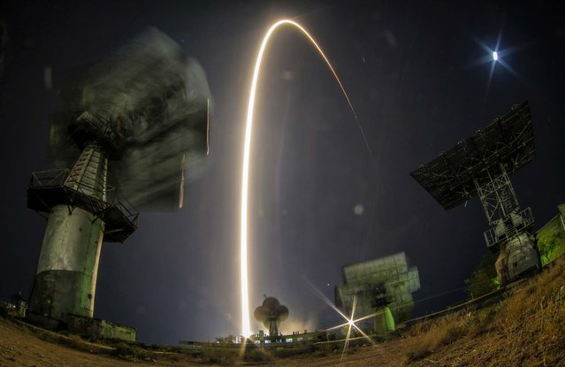 The Soyuz-FG rocket booster with Soyuz TMA-10M space ship carrying a new crew to the International Space Station, ISS, blasts off at the Russian leased Baikonur cosmodrome, Kazakhstan, on September 26, 2013. The Russian rocket carries U.S. astronaut Michael Hopkins, Russian cosmonauts Oleg Kotov and Sergey Ryazanskiy. (Photo by Dmitry Lovetsky/Associated Press)