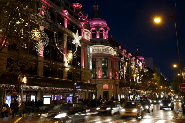 Cars drive on a street illuminated with Christmas lights on Boulevard Haussmann in Paris, France, November 8, 2015. (Photo by Benoit Tessier/Reuters)