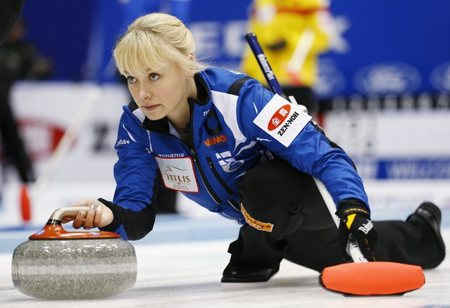 Finland's skip Sanna Puustinen delivers a stone during her curling round robin game against Denmark at the World Women's Curling Championships in Sapporo March 15, 2015. (Photo by Thomas Peter/Reuters)