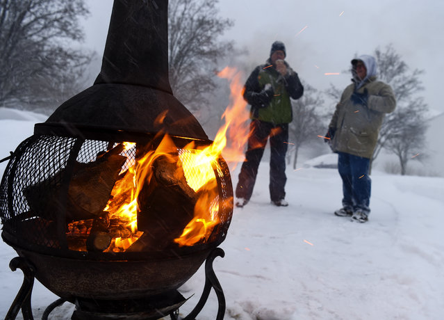 Al Hedin (L) and Rick Kosiba take a break from shoveling as a major snow storm hits the Washington DC region on January 23, 2016 in Crofton, MD. (Jonathan Newton/The Washington Post)