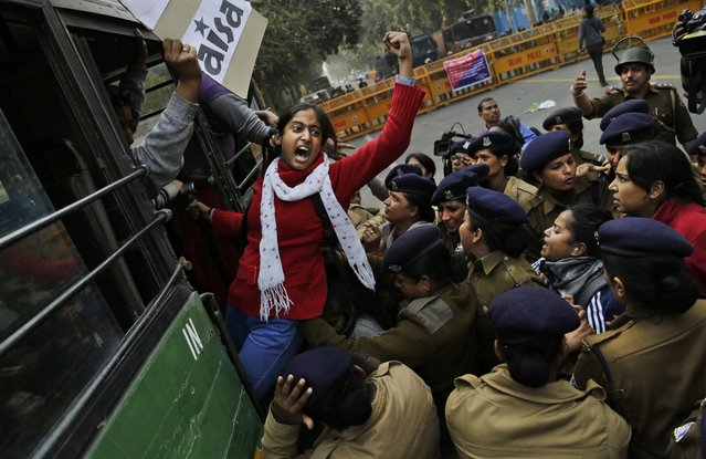 An Indian student shouts slogans demanding resignation of Indian education minister as she is detained by police during a protest against the death of student Rohith Vemula in New Delhi, India, Wednesday, January 27, 2016. The students were protesting the death of Vemula, who, along with 4 others, was barred from using some facilities at his university in the southern tech-hub of Hyderabad. The protesters accused Hyderabad University's vice chancellor along with two federal ministers of unfairly demanding punishment for the five lower-caste students after they clashed last year with a group of students supporting the governing Hindu nationalist party. (Photo by Altaf Qadri/AP Photo)