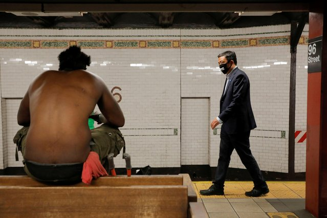 Democratic New York City Mayoral candidate Andrew Yang walks past a person in a subway station during the New York City primary mayoral election, in Manhattan, June 22, 2021. (Photo by Andrew Kelly/Reuters)