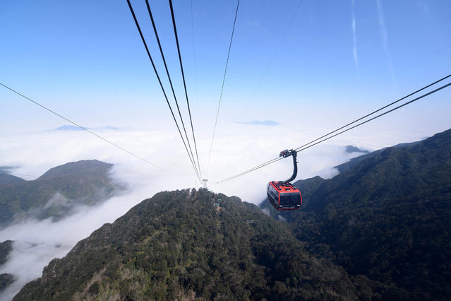 A cable car starting at the Muong Hoa valley and going to the peak of Fansipan Mountain, or the roof of Indochina, during the inauguration of the world's longest cable car, in Sapa, Lao Cai province, 02 February 2016. At 6,292 meters, it has been recognized as the world's longest three-rope cable car by the Guinness World Records and has the world's biggest height gap, 1,410 meters, between its departure and arrival stations, according to media reports. (Photo by EPA/Stringer)