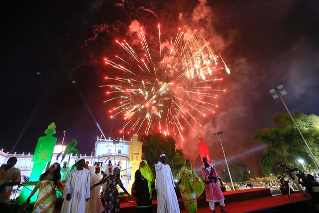 Fireworks are seen behind traditional performers after Sudan's President Omar Al Bashir addressed the nation during the country's 61st independence day, at the presidential palace in Khartoum, Sudan December 31, 2016. (Photo by Mohamed Nureldin Abdallah/Reuters)
