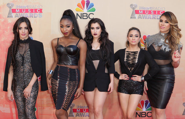 Camila Cabello, from left, Normani Kordei, Lauren Jauregui, Ally Brooke Hernandez and Dinah Jane Hansen, of Fifth Harmony, arrive at the iHeartRadio Music Awards at The Shrine Auditorium on Sunday, March 29, 2015, in Los Angeles. (Photo by John Salangsang/Invision/AP Photo)