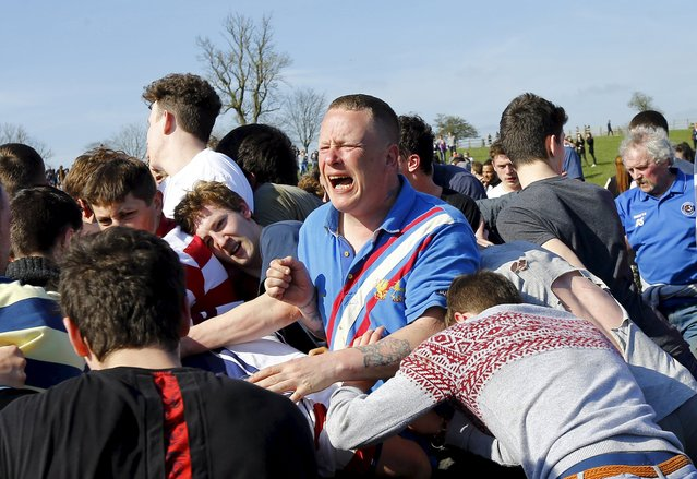 A player reacts in the scrum during the bottle-kicking game in Hallaton, central England April 6, 2015. (Photo by Darren Staples/Reuters)