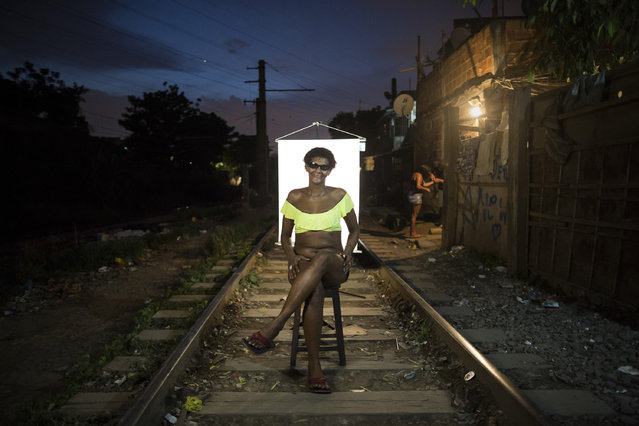 "In this March 18, 2015 photo, Carla Chris, 35, poses for a portrait in an open-air crack cocaine market, known as a ""cracolandia"" or crackland where users can buy crack, and smoke it in plain sight, day or night, in Rio de Janeiro, Brazil. Carla Chris, who has been using crack for over 6 years, says getting into crack was easy. What is difficult is finding an opportunity on the outside. But she pushes herself everyday, saying: ""Smile because life is beautiful. Jesus loves you and victory is certain. I am capable, prepared and self-sufficient, so I can do for myself"". (Photo by Felipe Dana/AP Photo)"