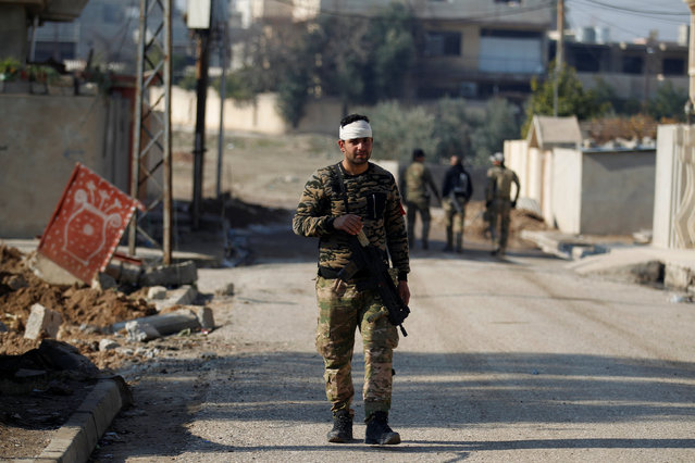 A member of the Iraqi rapid response forces walks during a battle with the Islamic State militants in the Mithaq district of eastern Mosul, Iraq, January 5, 2017. (Photo by Khalid al Mousily/Reuters)