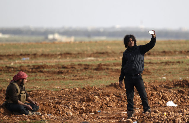 A Free Syrian Army fighter takes a selfie near Qabasin town, during an offensive against Islamic State fighters to take control of Qabasin town, near the northern Syrian town of al-Bab, Syria January 12, 2017. (Photo by Khalil Ashawi/Reuters)