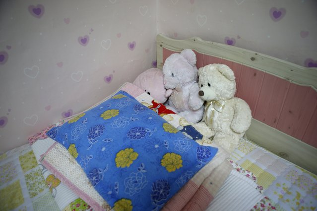Teddy bears belonging to Kim Ju-hee, a high school student who died in the Sewol ferry disaster, lie on a bed in her room in Ansan April 8, 2015. Her dream was to be a doctor. (Photo by Kim Hong-Ji/Reuters)