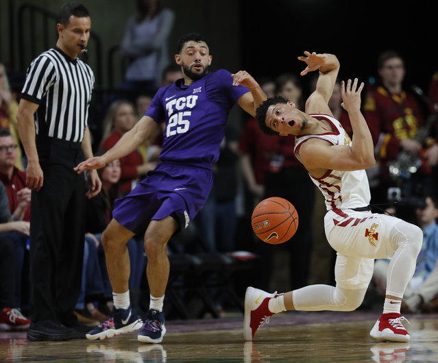 TCU guard Alex Robinson, left, pokes the ball away from Iowa State guard Lindell Wigginton, right, during the first half of an NCAA college basketball game, Saturday, February 9, 2019, in Ames. (Photo by Matthew Putney/AP Photo)