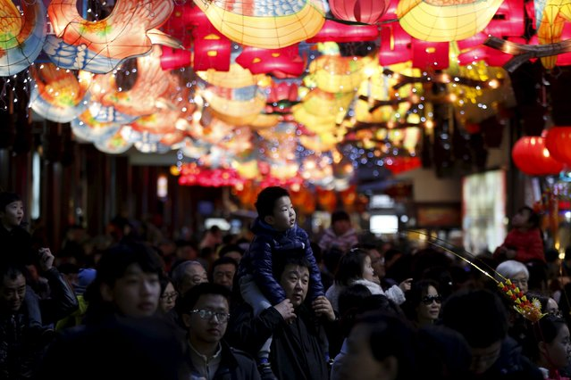 People walk in an area decorated with lanterns ahead of the Lantern Festival at Yu Yuan Garden in downtown Shanghai, China, February 20, 2016. (Photo by Aly Song/Reuters)