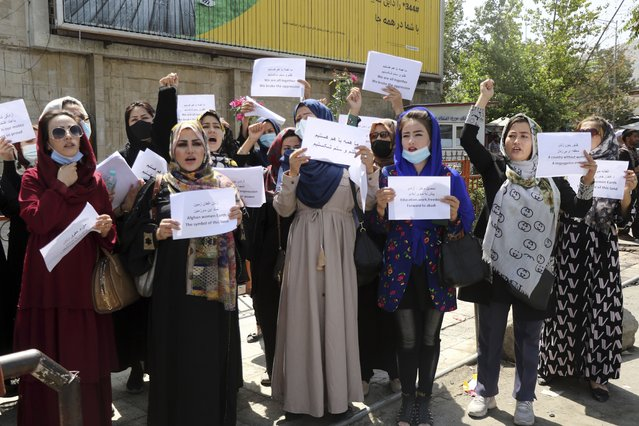 Women gather to demand their rights under the Taliban rule during a protest in Kabul, Afghanistan, Friday, September 3, 2021. As the world watches intently for clues on how the Taliban will govern, their treatment of the media will be a key indicator, along with their policies toward women. When they ruled Afghanistan between 1996-2001, they enforced a harsh interpretation of Islam, barring girls and women from schools and public life, and brutally suppressing dissent. (Photo by Wali Sabawoon/AP Photo)