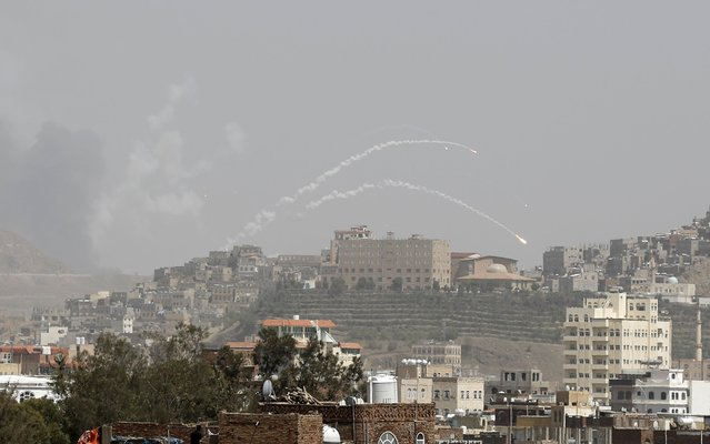 Rockets fly from a missile base which was hit by an air strike in Yemen's capital Sanaa April 21, 2015. (Photo by Khaled Abdullah/Reuters)