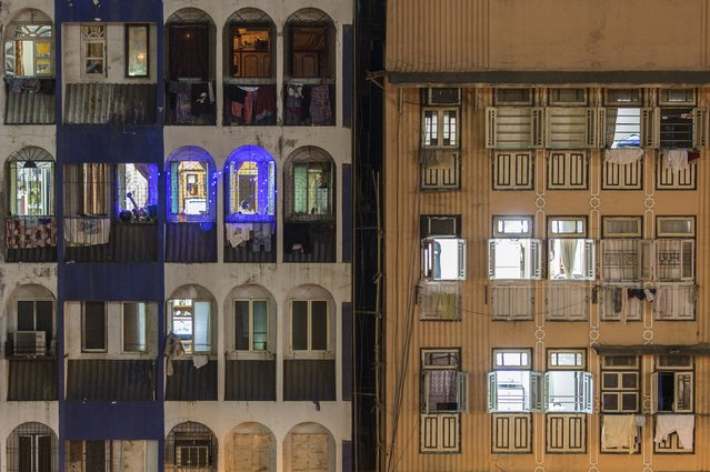 Windows of residential buildings are pictured in south Mumbai January 22, 2015. The cost for buying a residential apartment in Mumbai close to the city centre ranges from 12,000 Indian rupees ($ 200) per square feet to 112,552 Indian rupees ($ 1800) per square feet. (Photo by Danish Siddiqui/Reuters)