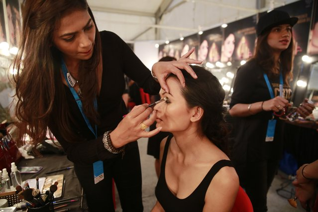 In this February 1, 2017 photo, a makeup artist applies eye-shadow on Anjali Lama, a transgender model from Nepal, during Lakme Fashion week in Mumbai, India. (Photo by Rafiq Maqbool/AP Photo)