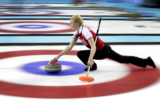 Russia's Alexandra Saitova delivers the rock during the women's curling competition against Denmark at the 2014 Winter Olympics, Monday, February 10, 2014, in Sochi, Russia. (Photo by Wong Maye-E/AP Photo)