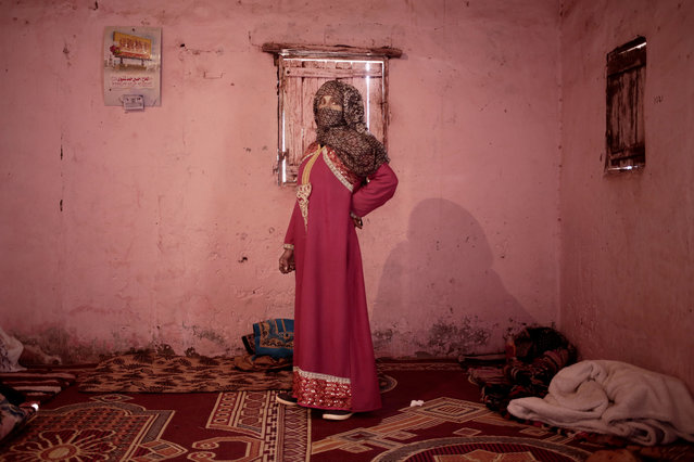 In this March 31, 2019 photo, Umm Yasser, the first female Bedouin guide from the Hamada tribe, poses for a photograph in her home in Wadi Sahw, Abu Zenima, South Sinai, Egypt. (Photo by Nariman El-Mofty/AP Photo)