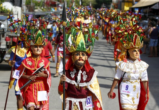 """Penitents locally called """"Morions"""" parade during the start of Holy Week celebrations in Mogpog, Marinduque in central Philippines March 21, 2016. (Photo by Erik De Castro/Reuters)"""