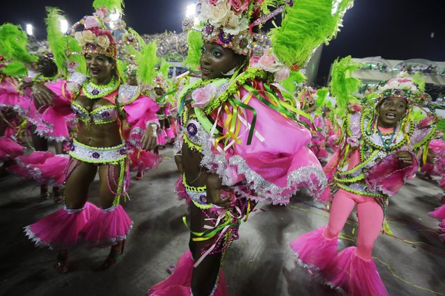 Performers from the Mangueira samba school parade during carnival celebrations at the Sambadrome in Rio de Janeiro, Brazil, Monday, March 3, 2014. (Photo by Nelson Antoine/AP Photo)