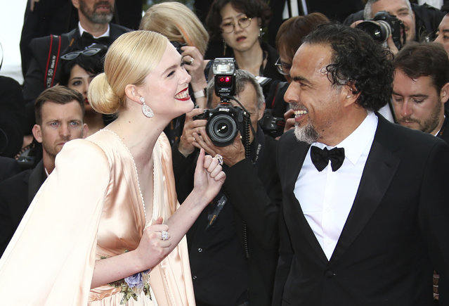 "Jury member Elle Fanning, left, and jury president Alejandro Gonzalez Inarritu pose for photographers upon arrival at the opening ceremony and the premiere of the film ""The Dead Don't Die"" at the 72nd international film festival, Cannes, southern France, Tuesday, May 14, 2019. (Photo by Joel C Ryan/Invision/AP Photo)"