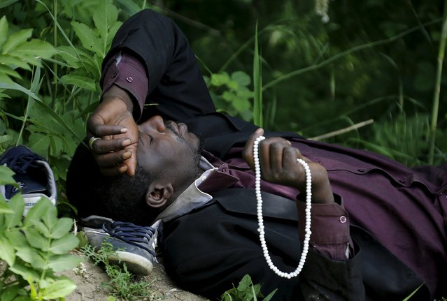 An  immigrant from Mali rests at the Greek-Macedonian border before an attempt to flee to Macedonia  May 13, 2015 village of Idomeni in Kilkis prefecture May 13, 2015. (Photo by Yannis Behrakis/Reuters)