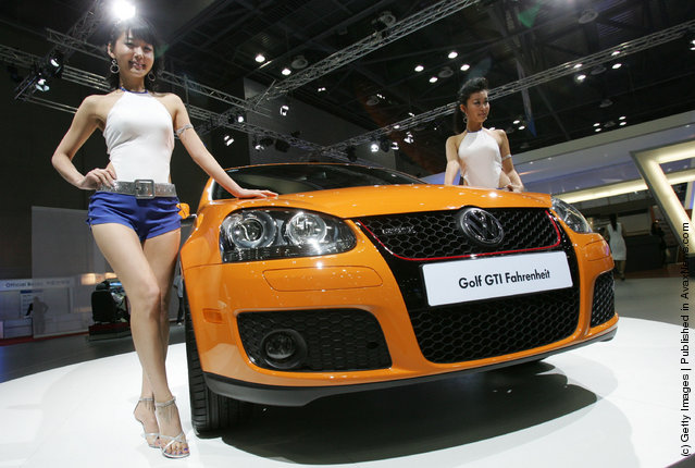 Models poses next to a Volkswagen Golf GTI Fahrenheit at the Seoul Motor Show