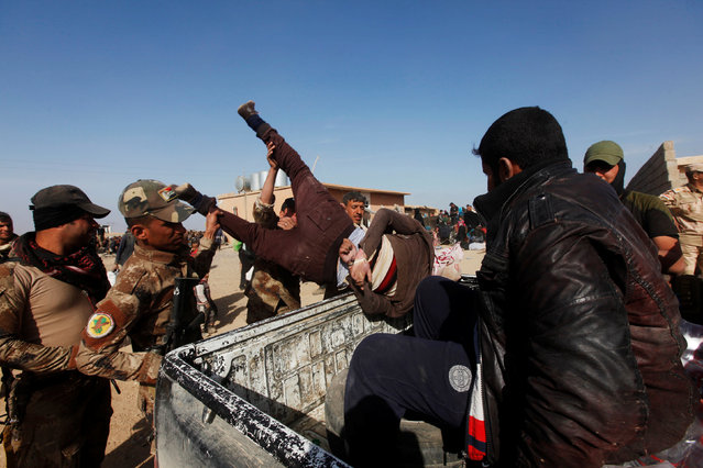 Iraqi Special Operations Forces arrest a person suspected of belonging to Islamic State militants in western Mosul, Iraq, February 26, 2017. (Photo by Alaa Al-Marjani/Reuters)