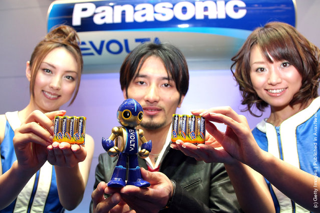 Creator of the 'EVOLTA' robot, Tomotaka Takahashi (C) introduces Panasonic's new alkaline battery EVOLTA series at Tokyo Midtown on January 15, 2008 in Tokyo, Japan. The new AA alkaline battery sets a Guinness World Record for the longest service life