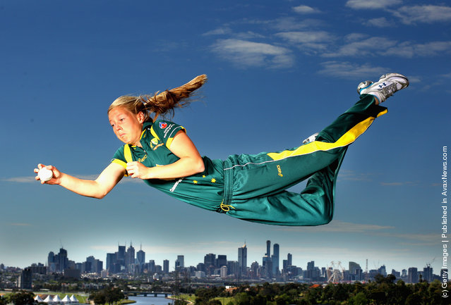 Victorian and Australian women's cricket team representative Meg Lanning dives for a catch during a photo shoot at Quarry Park