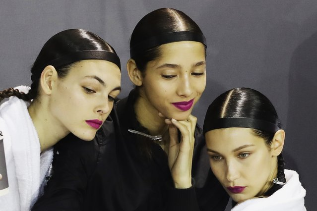 Vittoria Ceretti (1st left) and Bella Hadid (3rd left) prepare backstage before the  H&M Studio show as part of the Paris Fashion Week on March 1, 2017 in Paris, France. (Photo by Vittorio Zunino Celotto/Getty Images)