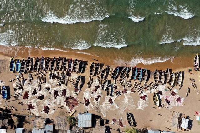 In this aerial view fishing boats are seen on the shore of the Lake Malawi at the Senga village on May 20, 2019 in Senga, Malawi. Hundreds of local traders gather each morning and afternoon at Senga, but fish populations are falling in Lake Malawi, Africa's third largest body of freshwater. (Photo by Gianluigi Guercia/AFP Photo)