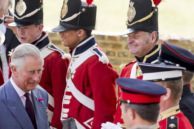 Britain's Prince Charles speak with the troops during a ceremony for the opening of the Hougoumont farm as part of the bicentennial celebrations for the Battle of Waterloo, near Waterloo, Belgium June 17, 2015. The commemorations for the 200th anniversary of the Battle of Waterloo will take place in Belgium on June 19 and 20. REUTERS/Geert Vanden Wijngaert/Pool
